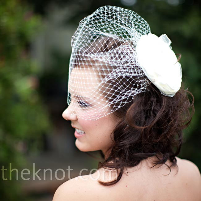 Courtney felt like a bride the moment she tried on the vintage birdcage veil with an ivory flower pinned to it.