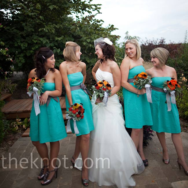 The bridesmaids wore strapless, knee-length aqua dresses with a box-pleat skirt and pockets.