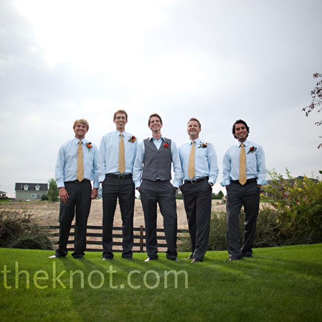 The four groomsmen wore charcoal gray pants with an aqua shirt and mustard ties.