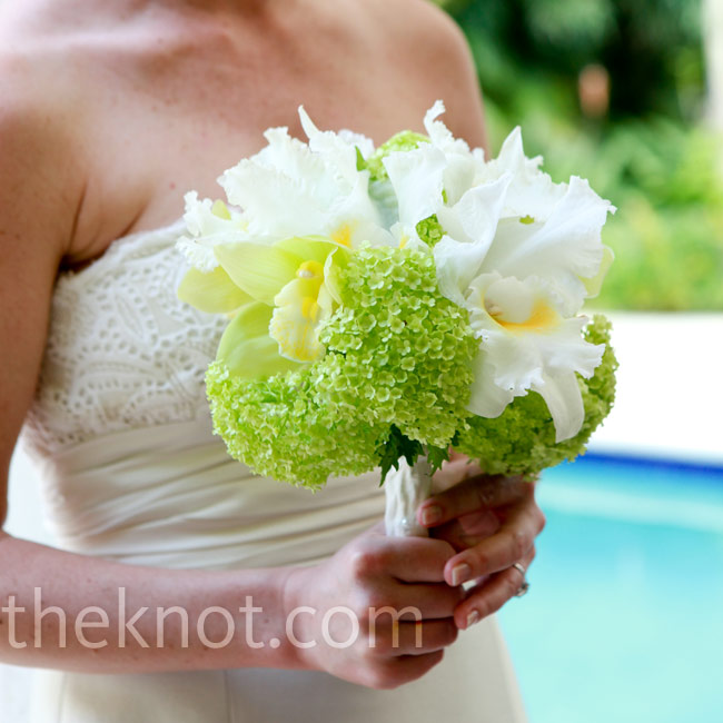 In keeping with the color scheme, Ashley carried a bridal bouquet of orchids and green hydrangeas.
