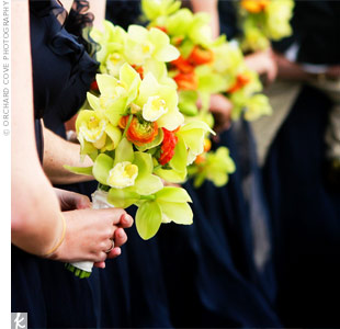 The 11 bridesmaids carried bundles of cymbidium orchids, which popped against their navy dresses.