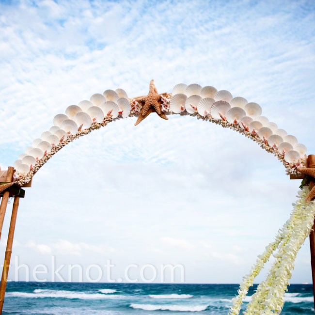 Their altar was made out of bamboo and seashells. Starfish and strands of fresh flowers finished the look.