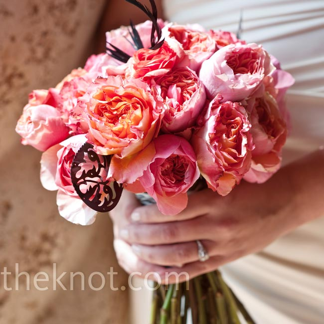Kelly had wanted giant coral peonies for her bouquet, but the blooms weren't in season. Instead, her florist found look-a-like garden roses, which Kelly loved.