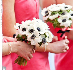 "Eight bridesmaids carried French anemones. ""I loved the contrast of the black center against their coral dresses,"" says Kelly."