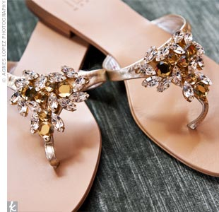 Kelly opted for comfort and style with these sparkly gold jeweled flip-flops.