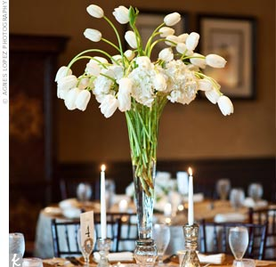 Tables were topped with two types of centerpieces, including tall glass vases with French tulips.