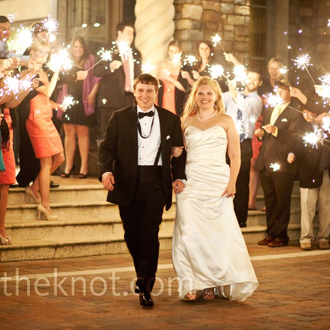 The newlyweds left through a tunnel of sparklers and rode away on a golf cart before hopping onto a bus to the after party.
