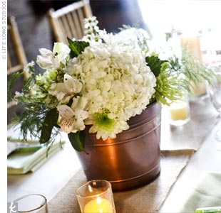 The hanging flowers from the ceremony aisle were re-purposed as centerpieces on the reception tables.