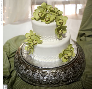 The white buttercream cake was decorated with green sugar cymbidium orchids (Neddy's favorite flower).