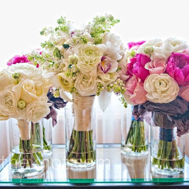 Silke carried an all-white bouquet of orchids, peonies, lilacs and ranunculus. Her maids' bouquets popped with pink peonies, pink roses and white ranunculus.