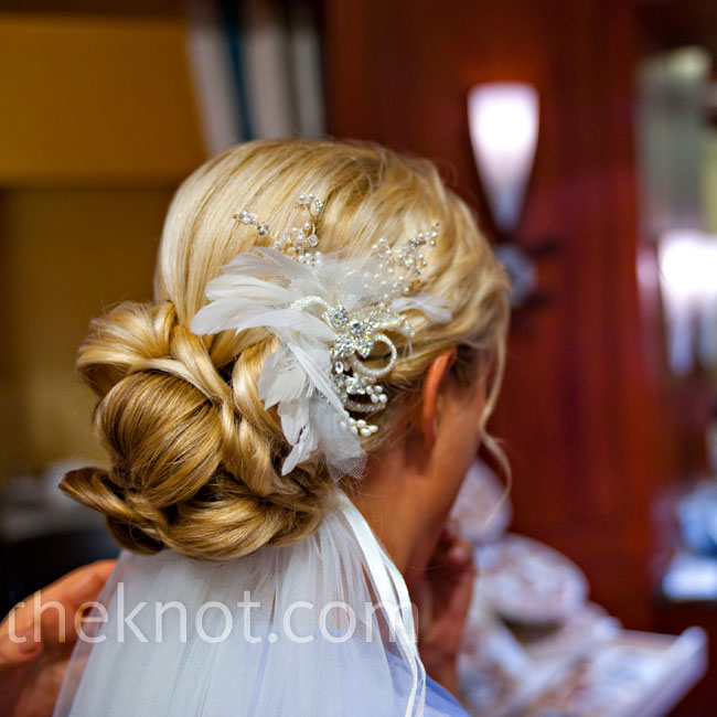 Silke wanted her hair to look romantic: it was curled and pulled back with crystal and white feather pins.