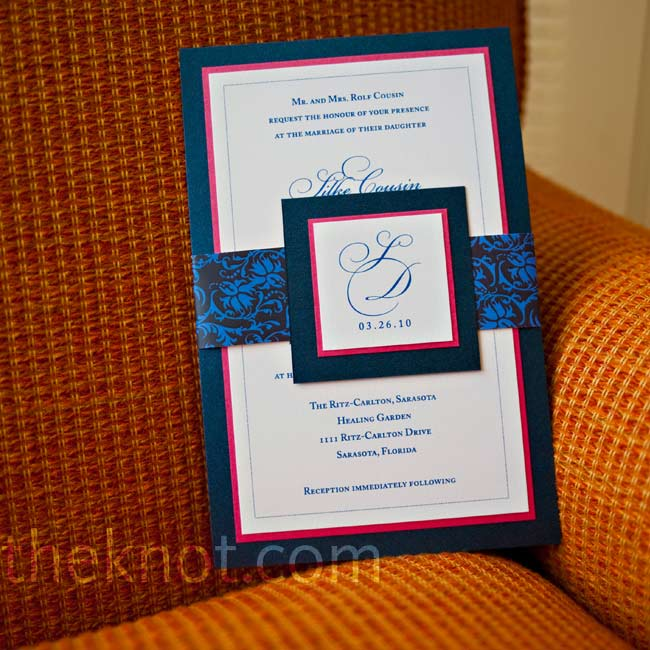 Guests received custom invitations. Each layered navy and pink card was tied with a patterned bellyband and monogrammed.