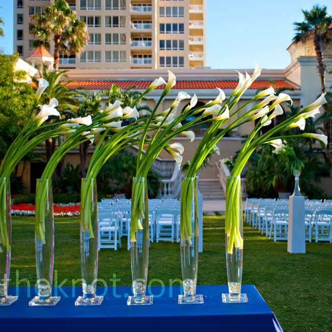 Vases filled with tulips and calla lilies were on display as guests made their way to the outdoor ceremony.