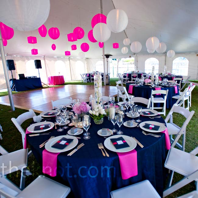 Pink napkins popped against navy blue linens and low centerpieces kept the look casual, yet elegant.