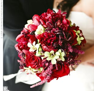 Jodi carried a mostly red bouquet of tulips, hanging amaranthus, burgundy peonies and black magic roses with a few carefully placed green dendrobium orchids.