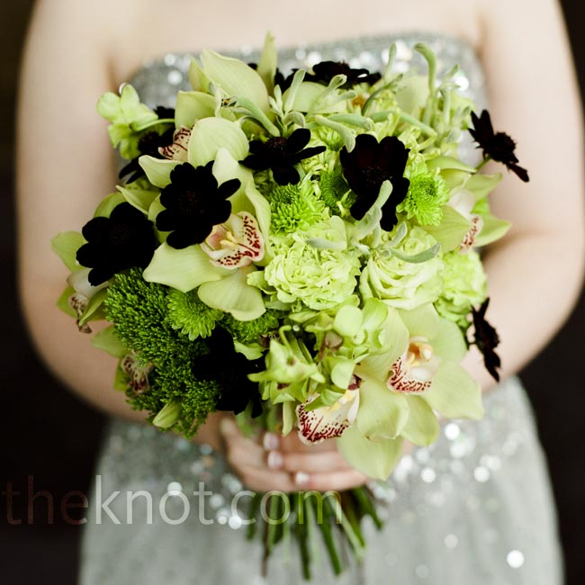 The chocolate cosmos in the bridesmaid bouquets popped against their lush green bouquets of orchids, roses, kangaroo paw and Kermit mums.