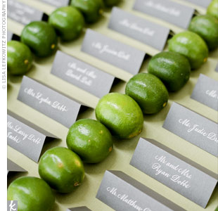 The couple's silver escort cards were neatly separated by rows of limes.