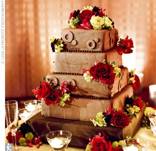 Jodi and Dave opted for a fondant-covered chocolate cake decorated simply with fresh roses and orchids.