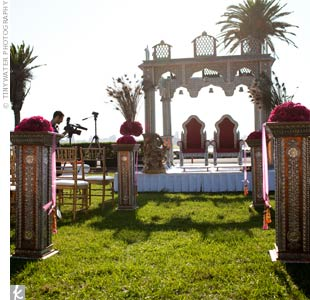 The ceremony took place with the San Francisco skyline in the background. Pink flowers and peacock feathers decorated either side of the mandap.