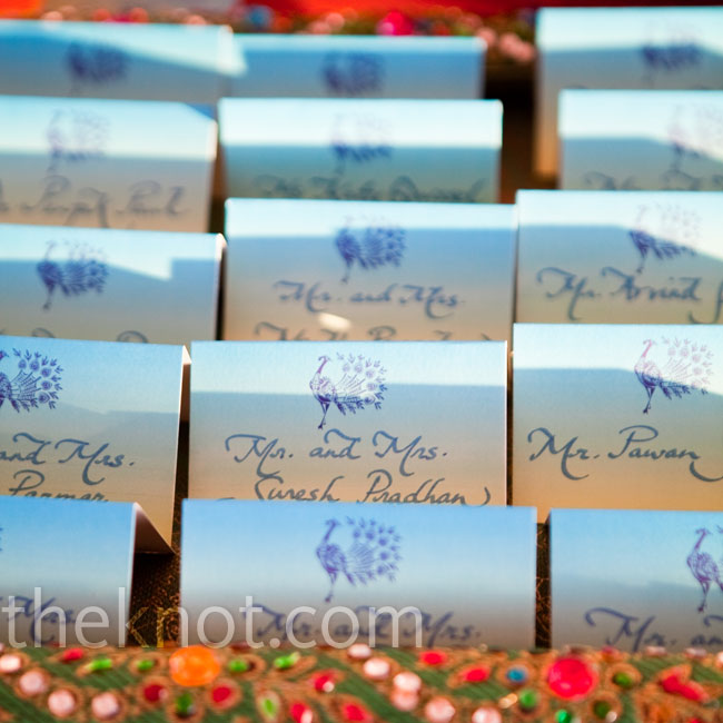 The escort cards featured a peacock motif, like all the paper elements. Shikha bought jeweled trays from India for the display.