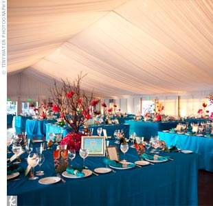 Beneath the tent, bright turquoise linens covered the tables, which were topped with Manzanita branches and pink flowers.