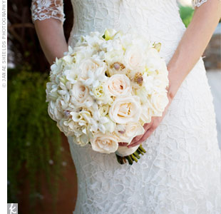 Stephanie carried a densely packed ivory and pale pink bouquet with flowers of varying shapes and sizes, including stephanotis.