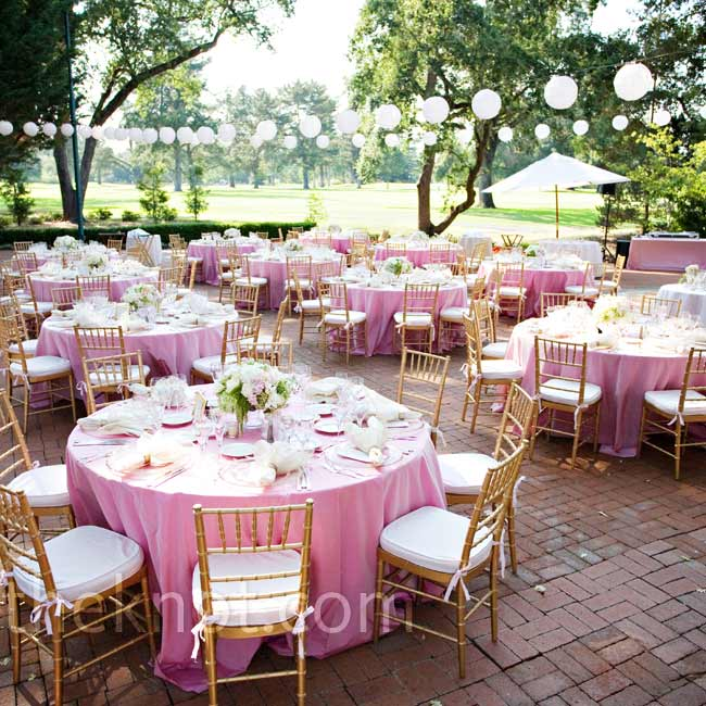 The grove's existing paper lanterns, brick-paved patio and manicured lawn fit into the wedding's classic style.