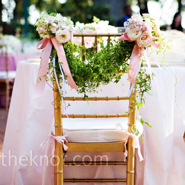 Stephanie and Trey sat at a sweetheart table with flower-embellished garland swung across the backs of their chairs.