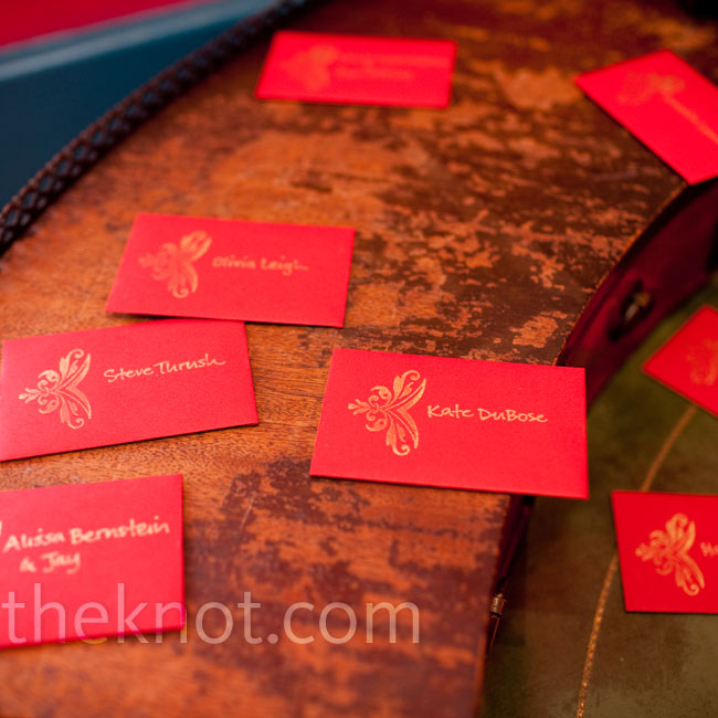 Guests found their table assignments at the club's entryway. Zena and her made business-card size cards, stamped them with a gold decal, and hand-wrote guests' names and table numbers.