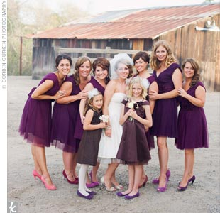 The bridesmaids wore plum tulle dresses from Anthropologie.