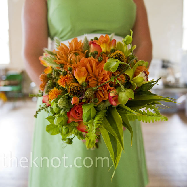 Similar to Adrienne's, her sister's bouquet was extra lush. The highlight: bright orange dahlias that popped against the greens.
