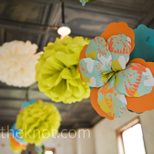 Colorful tissue paper poms and bright paper flowers hung from the ceiling.