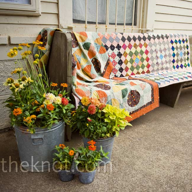 Adrienne and her sister prettied up the outdoor benches with a few quilts their mom made.