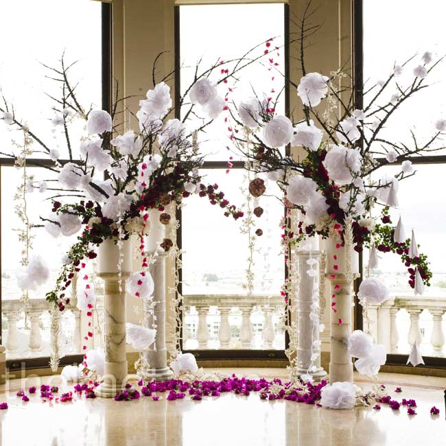 To rival the floor-to-ceiling windows, the huppah was made out of two oversize pillars decorated with fresh flowers, paper cranes and pipe cleaner flowers.