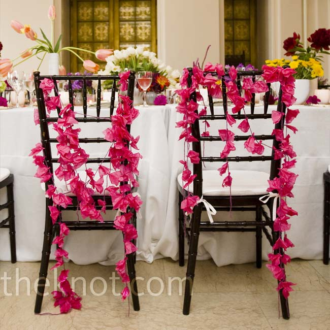 Niki and Ben's chairs were decorated with strings of hot pink origami to set them apart from the rest.