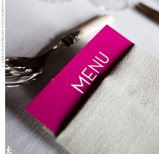 Hot pink menu cards were tucked into the white linen napkins for a pop of color.