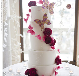 Fresh and paper flowers decorated the narrow, tall cake. Two carefully placed bigger paper butterfiles added extra springtime décor.