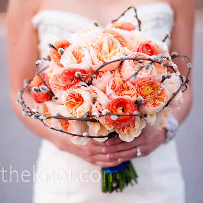 For a textured look, Jeanne carried a bouquet of garden roses and ranunculus with pussy willow loops wrapped around the perimeter.
