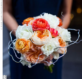 The bridesmaids carried ranunculus and garden roses like Jeanne, plus white tea roses.
