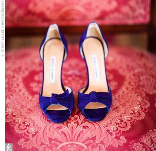 The first two pairs of shoes Jeanne bought made her look taller than Oscar. Her third -- these suede navy blue pumps -- were perfect.