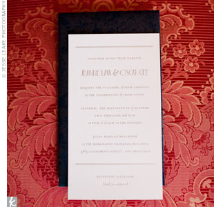 Jeanne and Oscar's friend designed their invitations. The backing had a blue and silver foil geometric pattern to match the Art Deco feel.