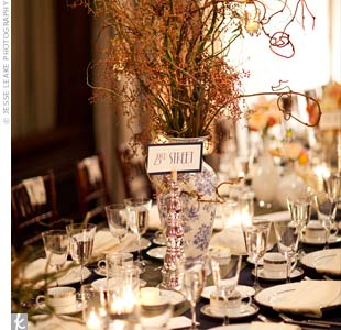 To add height to the long dining tables, vases were filled with a mix of curly willow, kiwi vine and local pistachio branches.