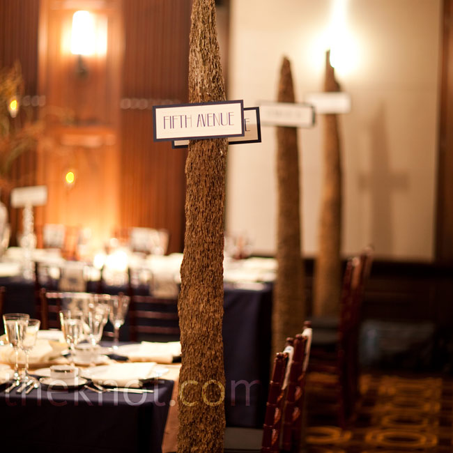 The driftwood pieces from the ceremony doubled as posts for the street signs at the reception.