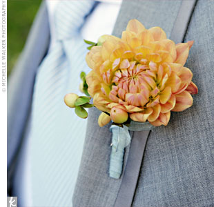 Orange dahlias popped against the gray tuxedos.