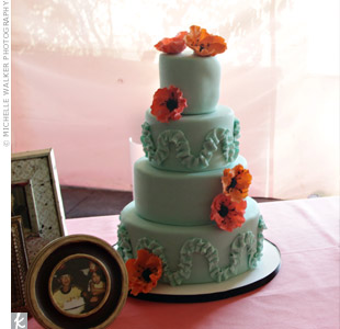 Jen and Mike served two adorable cakes; the more traditional four-tiered one had fondant poppies.