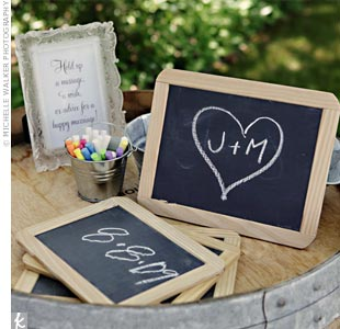 Guests wrote notes on mini chalkboards to hold while posing in the photo booth.