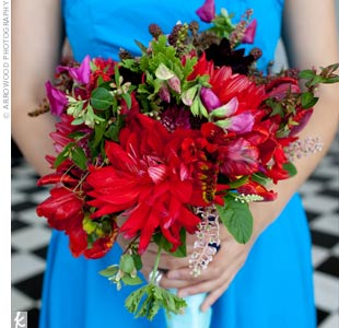 The bridesmaids' poppy red bouquets looked great against their aqua blue dresses.