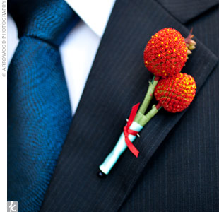 Special members of the family wore red-orange craspedia boutonnieres to match the groomsmen.