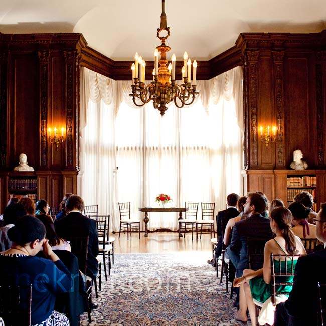 The Kohl Mansion's library reminded Meggy and Chris of the one at Yale, where they met, so it was the perfect place for the ceremony. The wood paneling and bay windows needed little decor, so they just added a few flowers.
