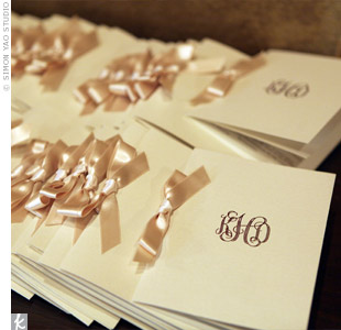 The ivory programs were tied together with gold ribbons and embossed with the couples monogram. The quote, Some people come into our lives and quickly go. Some stay for awhile and leave footprints on our hearts, And we are never ever the same, was printed on the back.